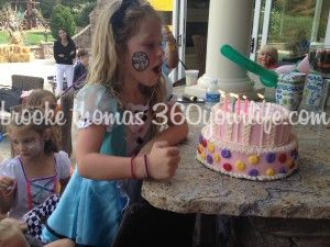 Blowing out her birthday cake